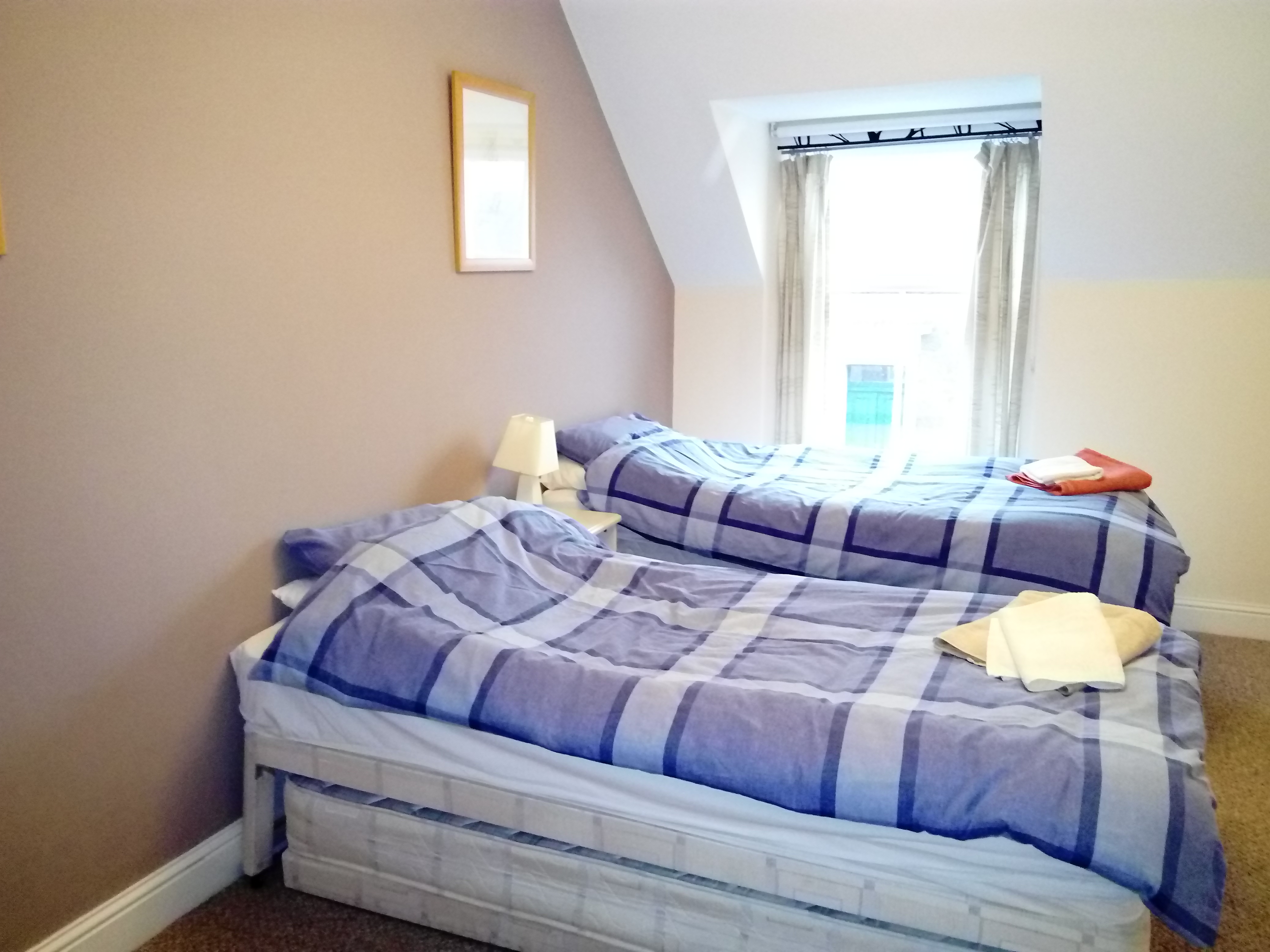 Twin bedded room which also equipped with a 3rd pull out bed